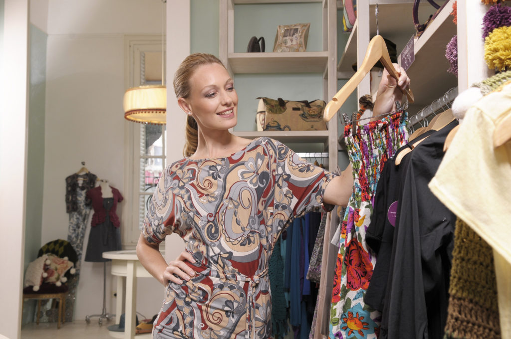 Confident Woman in Closet - Roxanne Carne